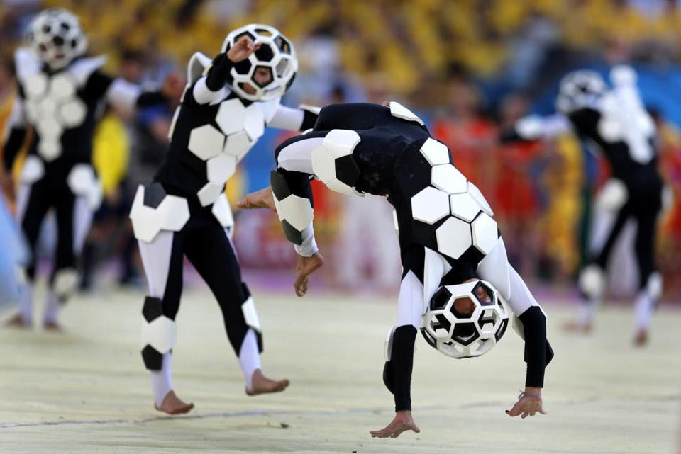 Dancers dressed in the spirit of soccer.