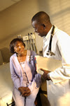 photo: older adult talking to her doctor