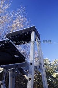a metal step ladder with icicles