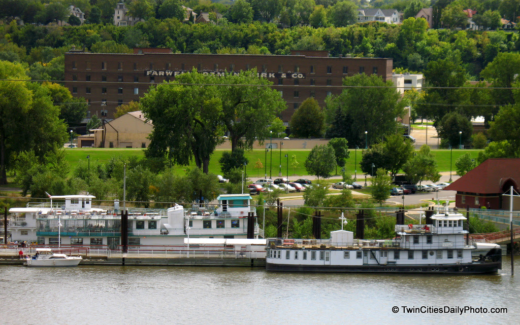 The large boat on the left is the River Boat Grill restaurant, while the boat on the right is the Covington Inn, a bed and breakfast.