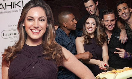 Kelly Brook wears sexy plum mini dress as she cosies up to Abercrombie and Fitch models for Mahiki's second birthday party in Dubai