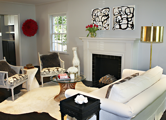 decorating living room with white walls red pouf