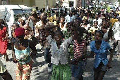 Haitians protest the lack of direct aid to the people of the Caribbean nation. An earthquake struck the country on Jan. 12, yet most people have not received the assistance they need. by Pan-African News Wire File Photos