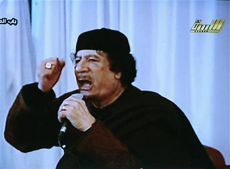 Libyan leader Muammar Gaddafi speaks to the people of this North African state that is under threat from imperialism. Libya has fought off an internal counter-revolutionary rebellion since Feb. 17, 2011. by Pan-African News Wire File Photos