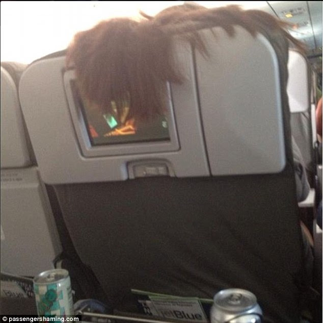 It was certainly a good flight for this passenger whose in-flight entertainment was interrupted by a mop of hair