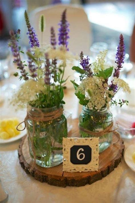 Picture Of a wood slice with two mason jars with