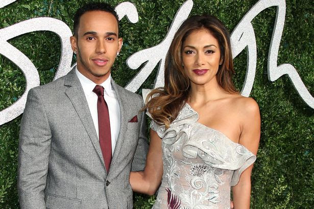 Lewis Hamilton and Nicole Scherzinger attend the British Fashion Awards at London Coliseum on December 1, 2014 in London, England