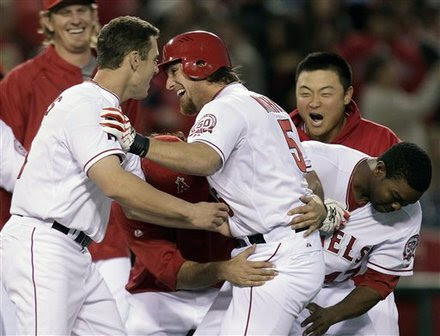 Los Angeles Angels' Jeff Mathis, Center, Is