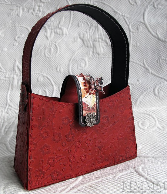 red crayon rubbed embossing purse