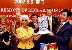 Mayor Lou Ann Palmer in Xiamen, China presenting a Photon gift to the leadership of our China Sister City in June 2007