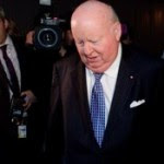 Sen_-Mike-Duffy-surrounded-by-media-as-he-leaves-Parliament-Hill-on-Oct_-22