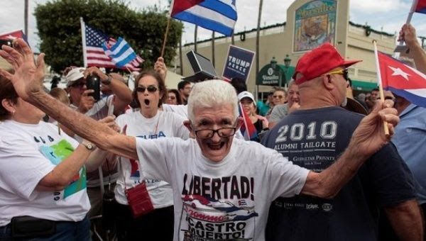 People celebrate after the death of Cuban revolutionary leader Fidel Castro in Miami, Florida, U.S., Nov. 26, 2016.