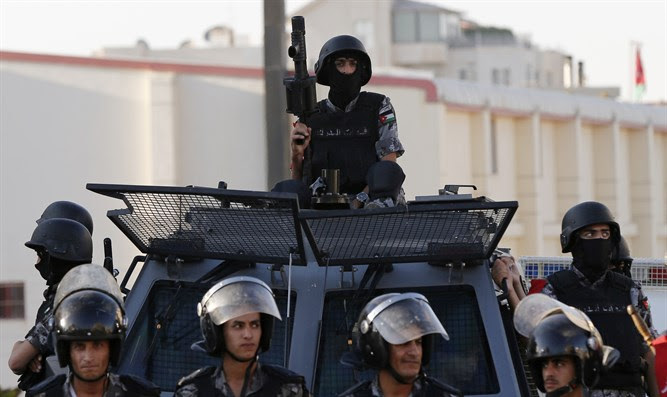 Jordanian police guard Israeli embassy in Amman following riots