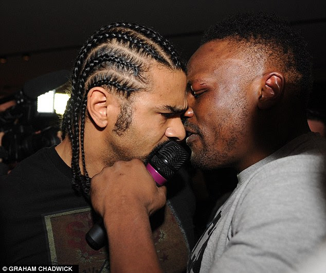 Enemies: Chisora and David Haye get up close and personal during the brawl