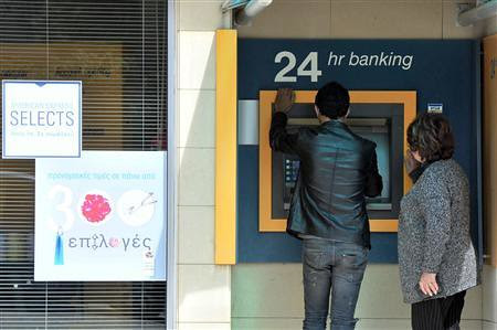 """People at Cyprus atm machine where a European Central Bank """"bailout"""" could take 10 percent of people's savings from their accounts. The island is suffering an economic crisis requiring a bailout by the continental financial institution. by Pan-African News Wire File Photos"""