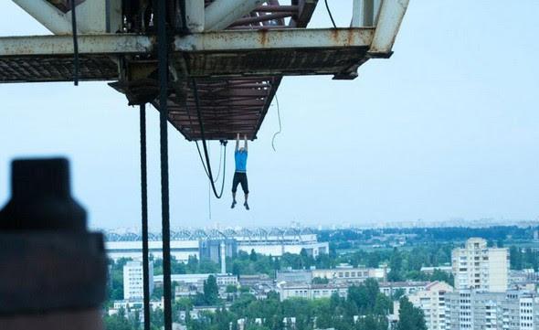 dizzying photos of ukrainian daredevil hanging from tall buildings 06 in Dizzying Photos of Ukrainian Daredevil Hanging from Tall Buildings