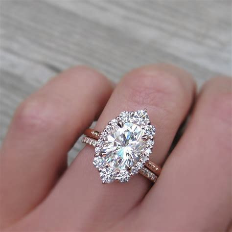 2.5 carat oval halo engagement ring paired with a conflict