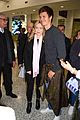 ansel elgort gets greeted by fans at australia airport 01