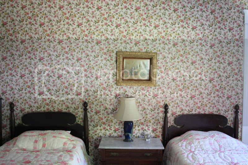 twin beds with vintage wallpaper