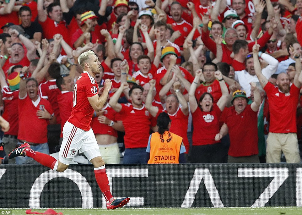 Ramsey celebrates in front of his country's adoring supporters after scoring during the Euro 2016 Group B fixture