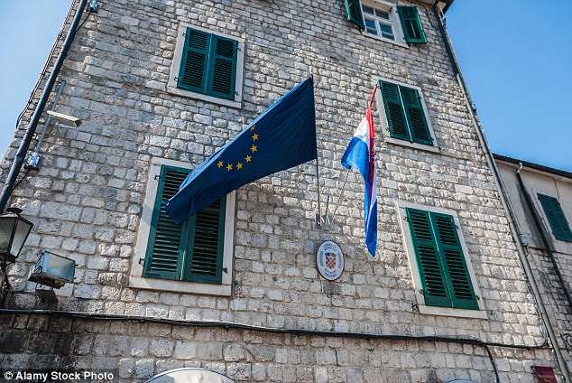 Operation: Robbers staked out the Croatian embassy in Montenegro (pictured), which was fenced off and fitted with CCTV cameras, before stealing the ambassador's 'unique jewellery'