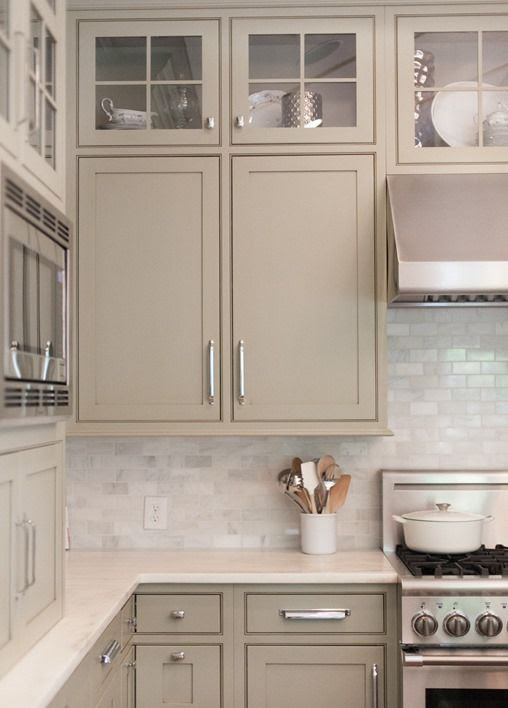 Neutral Painted Cabinets. Gray, greige, taupe, and gray greens offer a nice change to the stark white kitchens we've love but have seen over and over – the slightly warmer yet neutral hues feel elegant and refined.