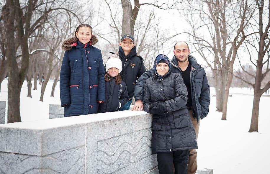 Sara, Batoul, Adel et leurs parents, Marwa et Feras Darwish, au parc La Fontaine