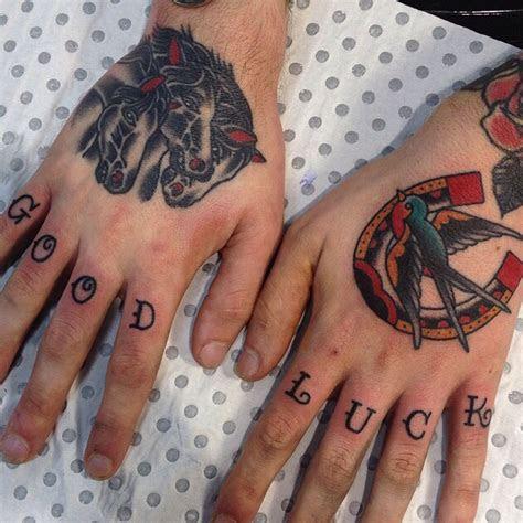 traditional hand tattoos hoseshoe sparrow goodluck