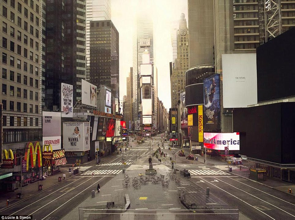 Times scare: New York's normally bustling crossroads of the world is missing all but one person in this Lucie and Simon photograph