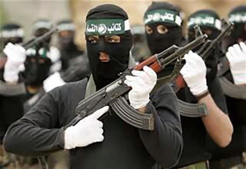 [Photo of masked radical riflemen]