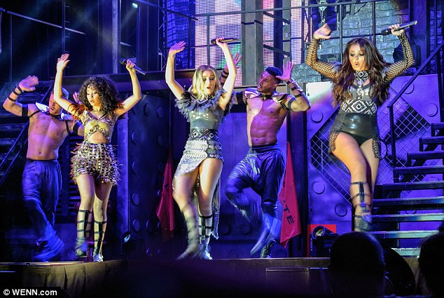 Hands up: Perrie, Leigh-Anne and Jesy seemed to unleash their inner warrior princess in another outfit change which saw the girls sport gladiator style attire