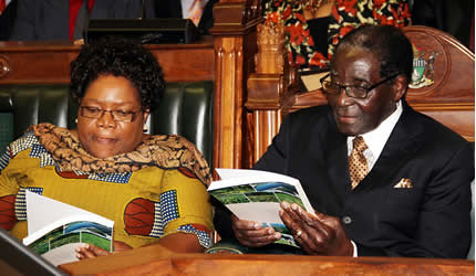 Republic of Zimbabwe President Robert Mugabe and Vice President Joice Mujuru reviewing the 2014 budget for the Southern African state. The budget was introduced in late December 2013. by Pan-African News Wire File Photos
