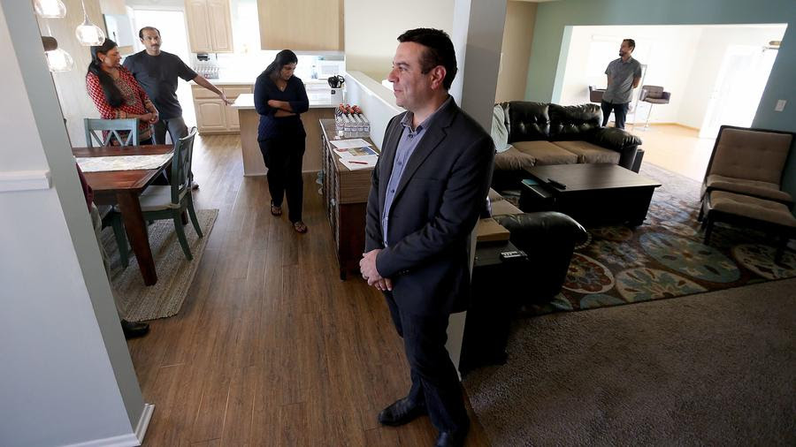 CANOGA PARK, CALIF. - APRIL 2, 2017. Realtor Houman Zahedi holds an open house at a three-bedroom,