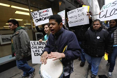 Students in Chicago protesting the closure of 61 school buildings by Mayor Rahm Emanuel, the former chief of staff for the Obama administration. The plan to close schools are being repeated throughout the United States. by Pan-African News Wire File Photos