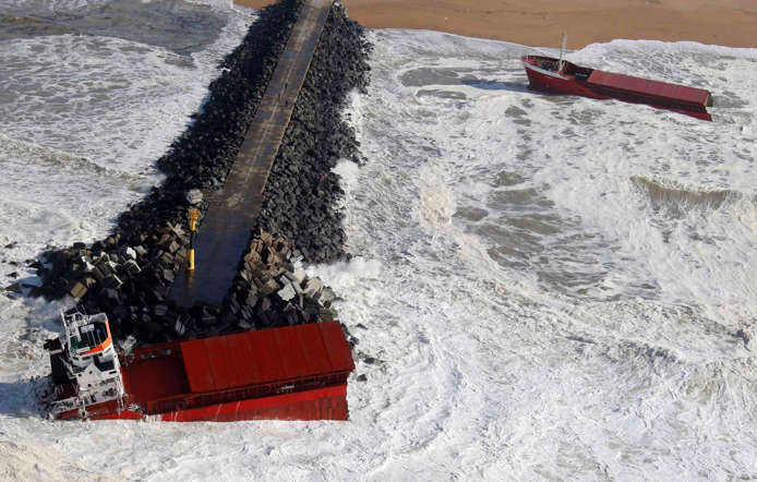An aerial view show waves as they break against a Spanish cargo ship carrying fertiliser, broken in two, off the beach in Anglet on the Atlantic Coast of France on February 5.