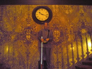 Mike in front of the Athenaeum clock