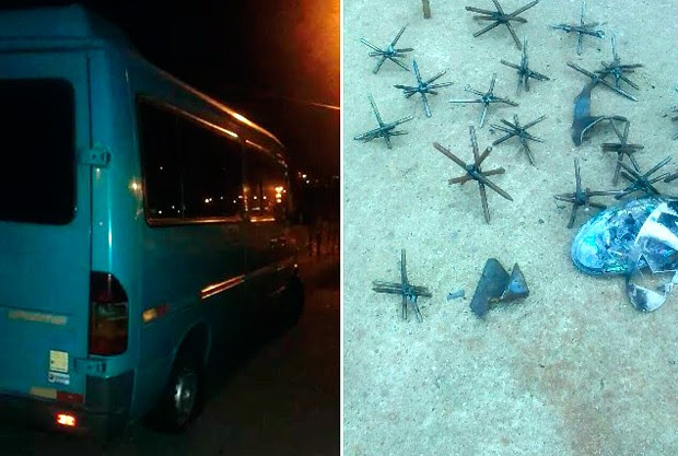 Van foi usada para bloquear entrada da cidade, e grampos de metal jogados na pista para impedir passagem dos carros da polícia (Foto: Valber Moura/G1)