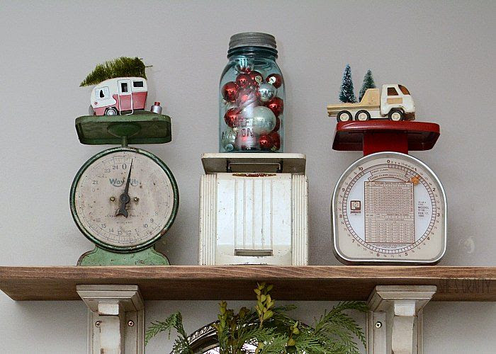 vintage car bottle of ornaments open shelving