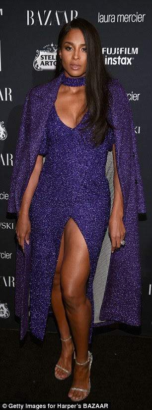 Matching:Ciara shrugged a longline blazer over her shoulders, which matched the royal hue of her dress, and added a complementing purple choker to her dress