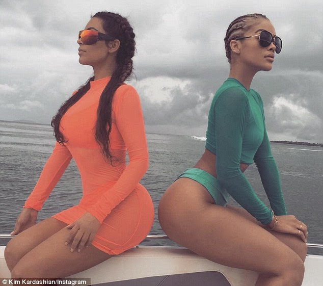 Social media maven: Later she also posted a snap to Instagram of her and Jasmine sitting back to back, apparently still on a boat