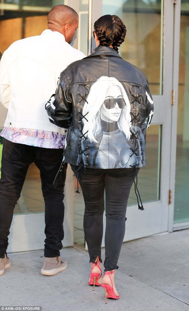 Bold look: The personalized jacket featured an image of Kim in a low-cut top on the back and sides