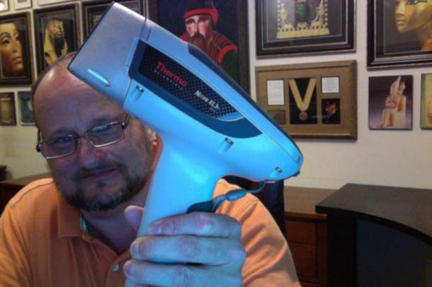 J. Hutton Pulitzer holding an XRF machine.