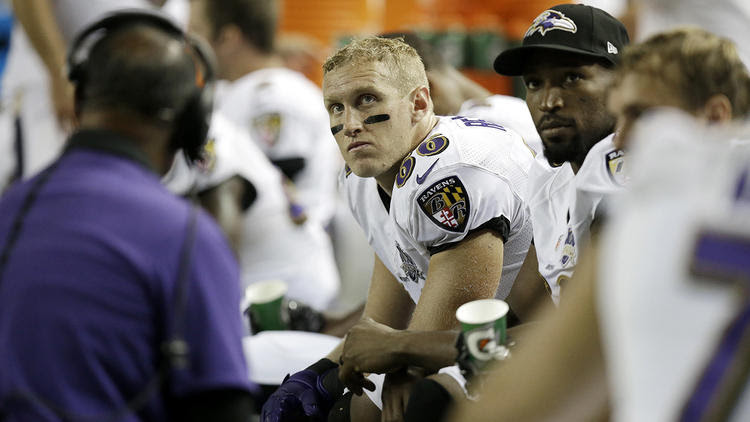 Konrad Reuland sits on the Ravens bench during an exhibition game against Atlanta.