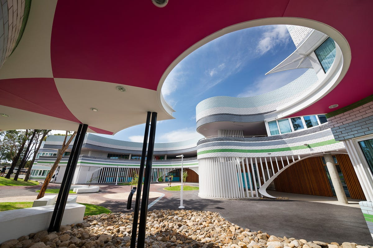 In Niddrie, Australia, the Penleigh and Essendon Grammar School features a jester-like color scheme. Sloping walls give the building a playful feel.