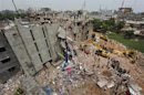 A view of rescue workers attempting to find survivors from the rubble of the collapsed Rana Plaza building in Savar