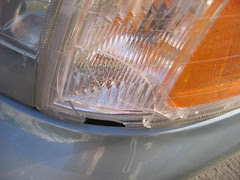 Broken headlight housing