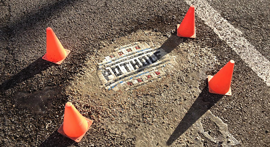 There's a Hero Repairing Chicago's Horrible Potholes With Mosaics