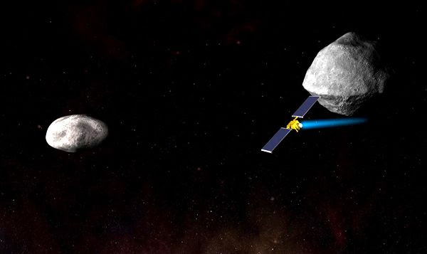 An artist's concept of NASA's Double Asteroid Redirection Test (DART) spacecraft about to collide with Didymos B (the smaller asteroid on the left).