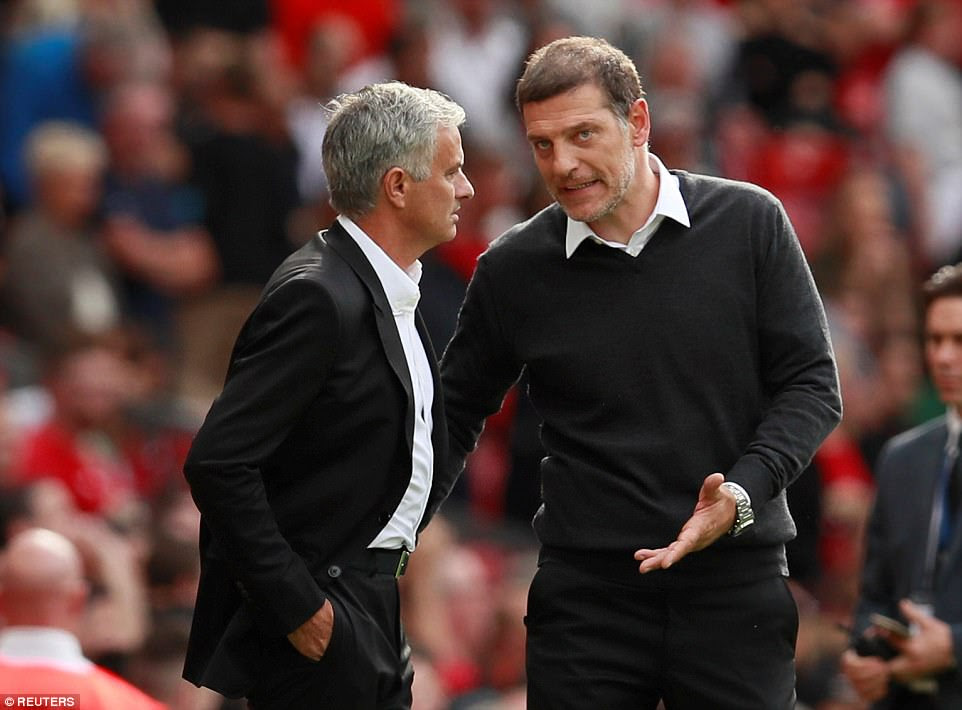 West Ham manager Slaven Bilic has a discussion with his Manchester United counterpart Jose Mourinho on the touchline