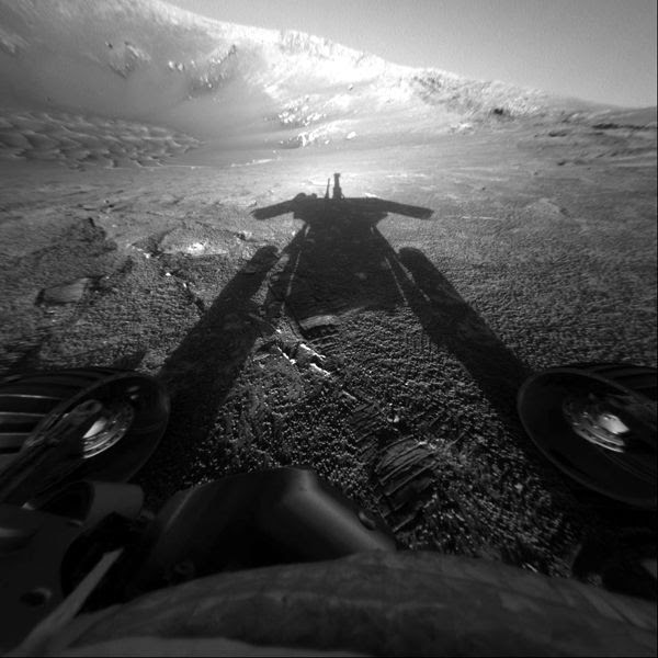 An image that NASA's Opportunity rover took of her own shadow on Mars...on July 26, 2004.